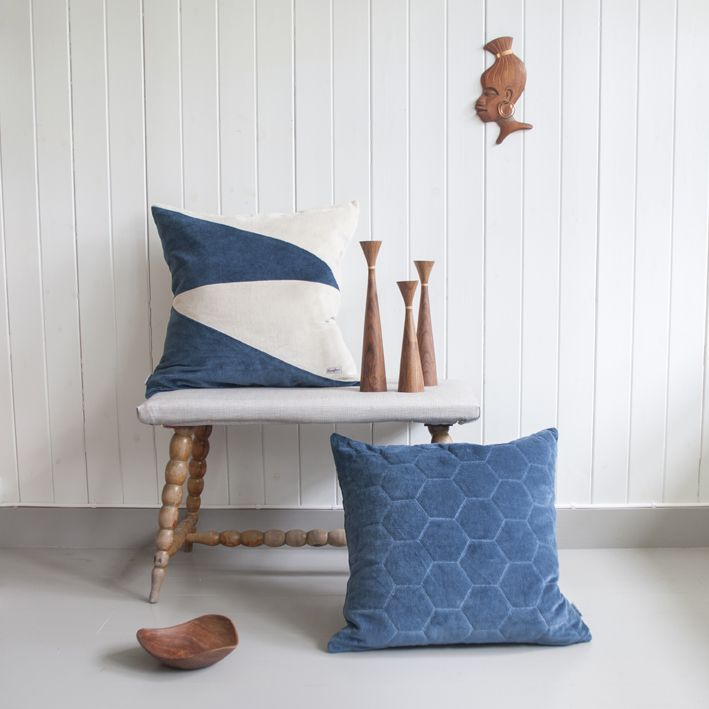 Velvet pillows in navy mixed with Alva bowl and Lydia candleholders in North Indian teak wood