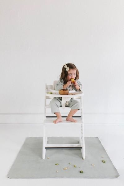 #gathre Highchair Mat in Ivy. Loved by moms everywhere. Simply wipe up food and spills on it's stain resistant surface - no laundering necessary.