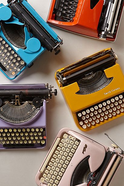 This site has a bunch of old typewriters in different colors. They're $700 each, but still.