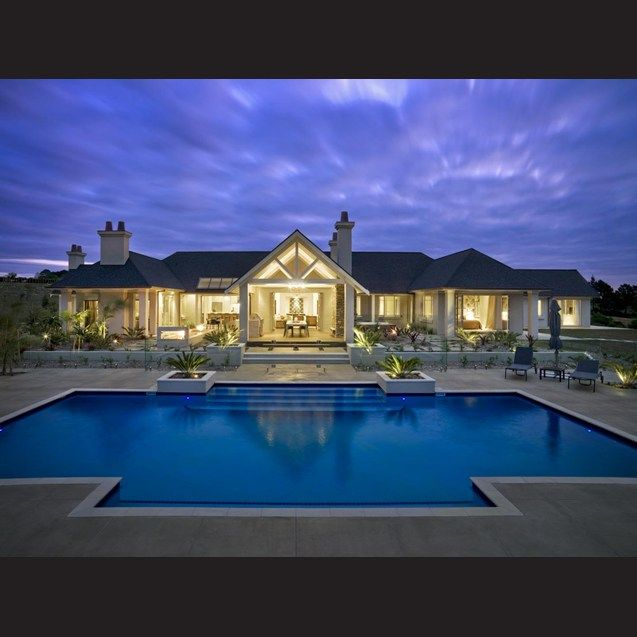 Glittering by night – this new masonry home built by Nautica Homes wraps around a large outdoor courtyard. A pavilion-style loggia provides an alfresco living area that is ideal for entertaining. The concrete pool, by Phil Brent of Ground Control International, has a sandstone surround and a dark blue quartz finish.