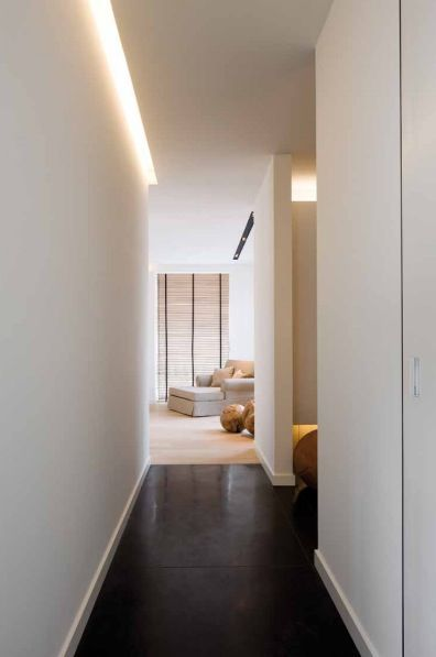Light facing down?  that would be helpful!    Cove lighting illuminates and defines the hallway. Warm White Strip Light by Lumilum. www.lumilum.com
