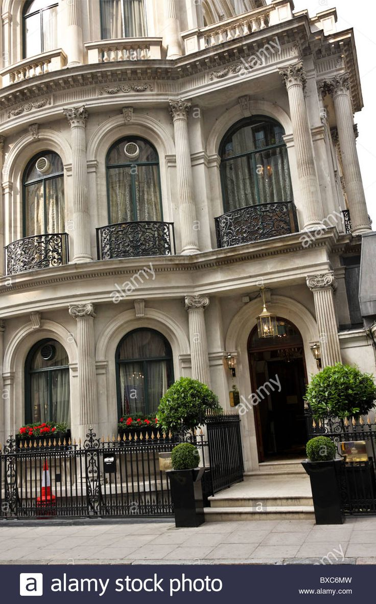 Gently angled aspect and main entrance to Les Ambassadeurs Club in Hamilton Place near Hyde Park
