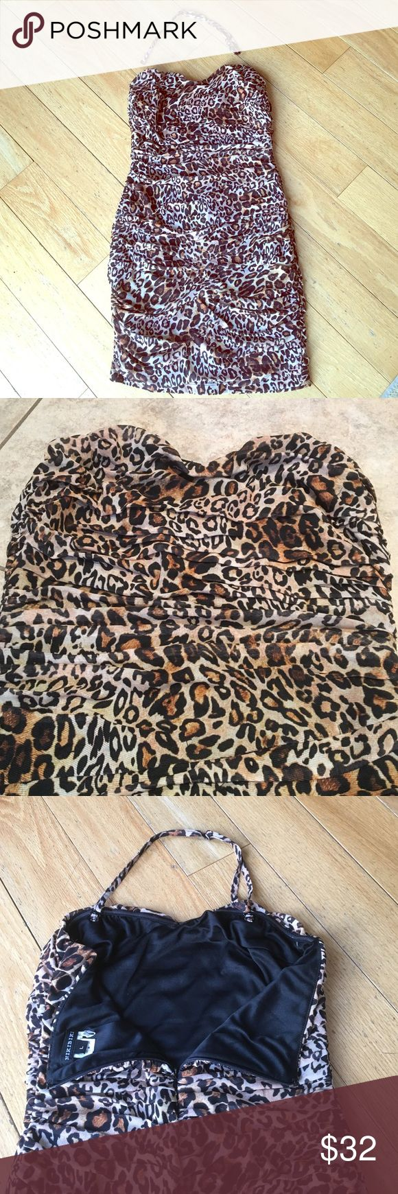 💥LIKE NEW SEXY STRAPLESS ANIMAL PRINT MINI DRESS 🔥Very Sexy Strapless Leopard/Animal Print Short Mini Dress With Sweetheart Top. Comes with removable halter strap if you need more support. Zip-up back. 90% polyester, 10% spandex, size large. SO SOFT & COMFY, you won't want to take this off! Worn Once, Like New!!! Smoke/pet free environment. Dresses Strapless