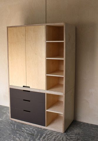 Plywood wardrobe and shelving storage system with a feature of stained drawers with open routed pull handles. Simplistic Scandinavian style plywood furniture.