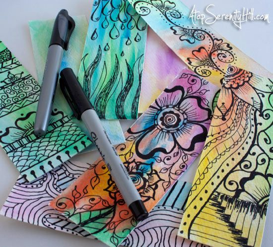 Doodling on watercolor postcards to make bookmarks • Atop Serenity Hill