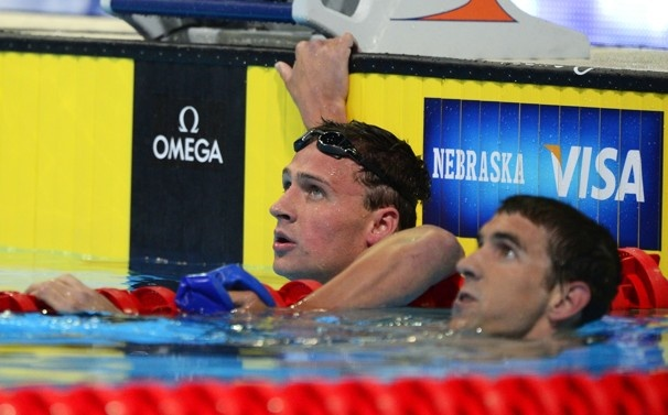 Ryan Lochte, left, and Michael Phelps watch the results in the men's 400-meter individual medley final at the US Olympic swimming trials. Lochte won the race