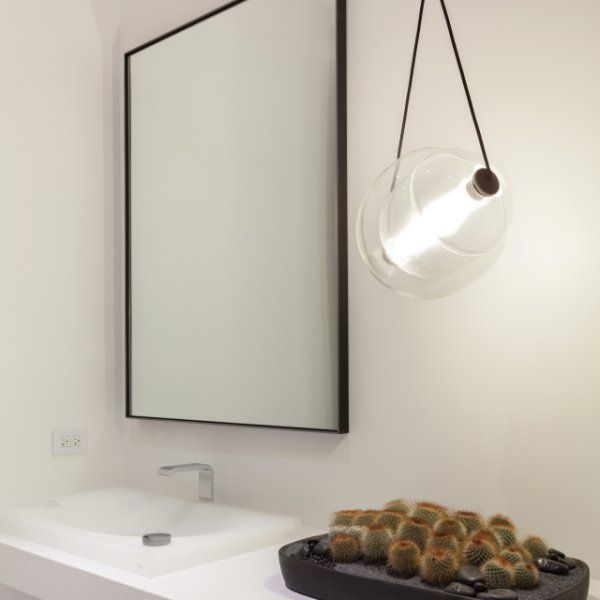 The Brokis Capsula LED Pendant is a striking synthesis of rounded glass chambers, overlapping and fusing together like a Venn diagram. The common factor is the tubular diffuser within, connecting the two glass cells and emitting a frosted LED light similar to a fluorescent lamp. The outer shell is left transparent while the interior is tinted, altering the coloration of the light, which is then capped with solid oak and harnessed by a decorative black cord. The complex design is made…