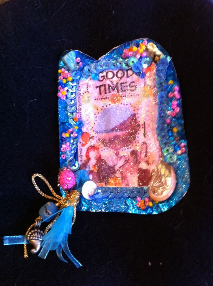 Worked metal jewellery with beads, shells, ribbons, feathers & image under resin