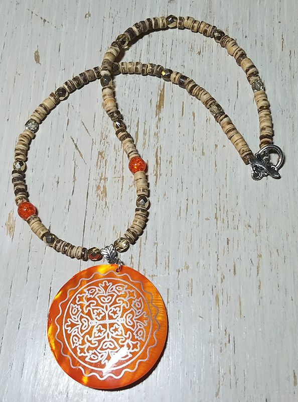 BSBP REVEAL! I am not a fan of orange, so this piece was the most challenging for me and it turned out lovely! The vintage orange mother of pearl pendant is strung on a necklace made of coconut palm beads with glass beads mixed in throughout. Maybe I will work with orange again one day!
