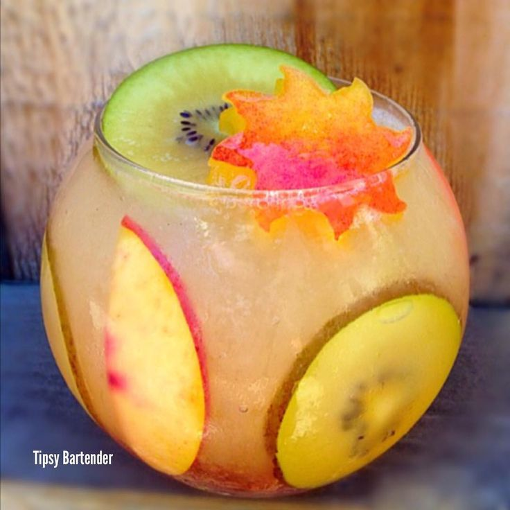PEBBLE BEACH 1 1/2 oz. (45ml) Rum 1 Whole Golden Kiwi 4 slices for Garnish & muddle the rest into rum 1/2 oz. (15ml) Pineapple Juice 1 oz. (30ml) Watermelon Puckers Top off with Squirt Soda Garnish : slices of nectarines & golden kiwi