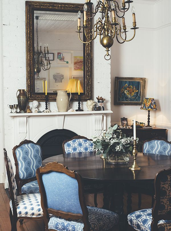 Inside interior designer Anna Spiro's charming Brisbane home. Loving the powder blue fabric with the dark wood of the chairs.