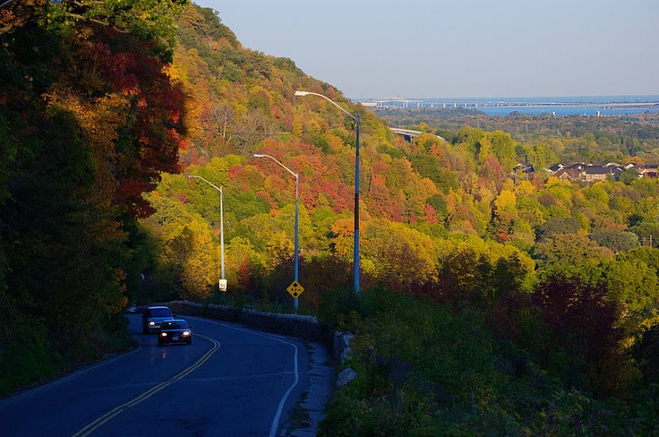 """""""The Dundas Cut""""  King Street winds up the mountain from Dundas with the Skyway bridge, Hamilton Harbour and Lake Ontario in the background"""
