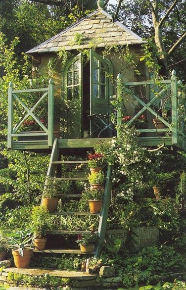 Garden summer house! WANT!!  Tree/Play house.  This link goes to a website for a garden designer's portfolio.  GORGEOUS pictures of many inspiring ideas for what can be done with outdoor spaces.