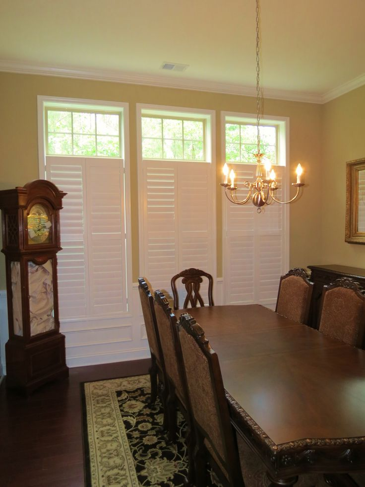 Plantation shutters with open transom in a dining room ...