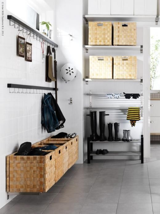 Mudroom idea: Shoe storage on slatted shelves for easier clean up, IKEA storage boxes mounted to wall