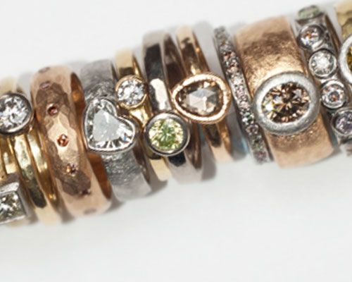 Selection of rings with various shape and colour diamonds, 18 carat yellow, white and rose gold, platinum.