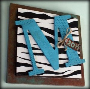 This is a project I did for a high school graduation gift. There are three mixed media techniques involved in the making that I am excited to share. I love how everything came together with this process. I was told she likes blues, and zebra print. I got the plain cardboard letter first and,