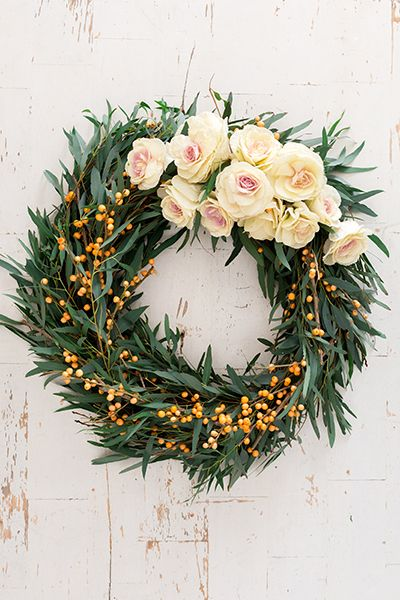 Loving this DIY holiday wreath with fresh greens and roses.