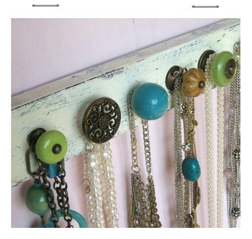 Door knobs on plywood.... holds jewelry, scarves, jackets, caps, etc...