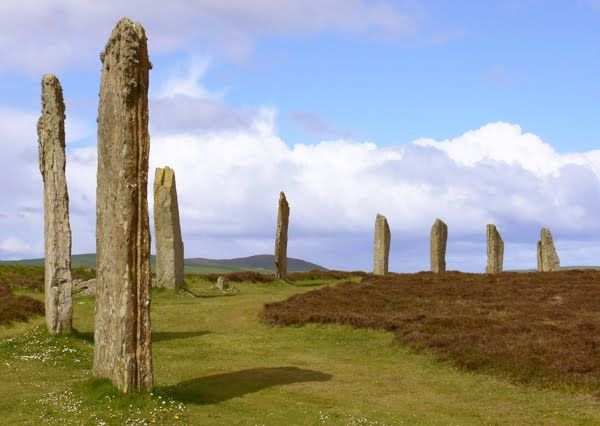 Ancient stone circle: the Ring of Brodgar, Orkney, Scotland. This is both an 'as it used to be' and 'as it is today' picture.