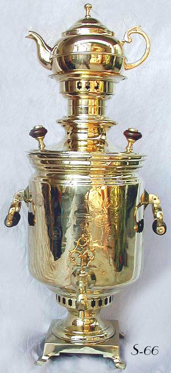 Rare Antique Imperial Russian Samovars. Award winning Magnificent Barrel Shaped Samovar c.1904, adorned with over 20 Award medals and exhibition stamps. Made by I. F. Kapyrzin Sons in Tula, Russia. Beautiful Stars of David decoration on crown and waist. Pictured with teapot A-18.  Maker: I. F. Kapyrzin Sons in Tula, Russia