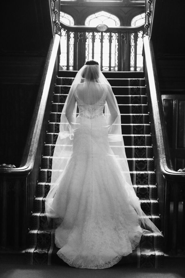 Bride on stairs at Dromoland