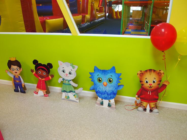 Daniel Tiger's Neighborhood 4th Birthday Party. Cardboard cutout of characters greeted guests
