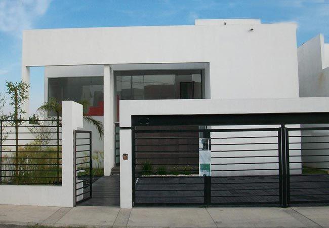 Fachada de casa moderna de dos niveles con garaje for Pisos decoracion garajes