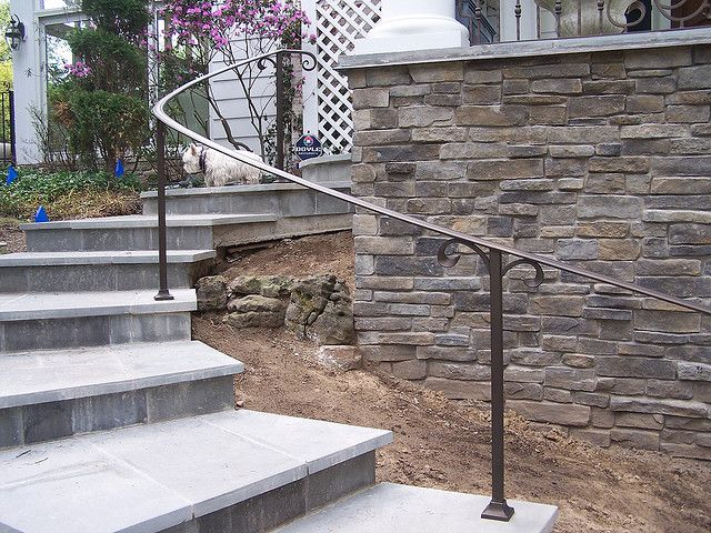 This Exterior Curved Wrought Iron Handrail Beautifull Complements The Stone  Stairs.