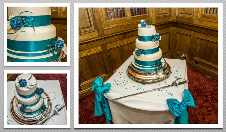 3 tier Wedding cake with blue ribbons and white and blue flowers.