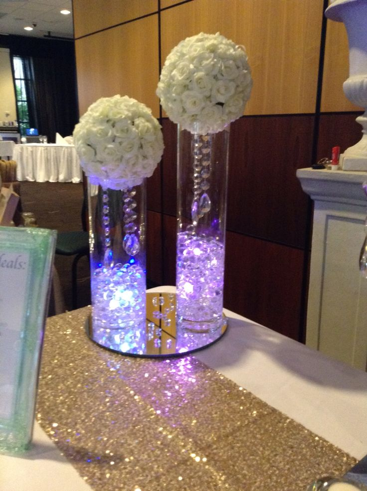 Duo of illuminated vases and hanging crystals. Stunning floral kissing ball