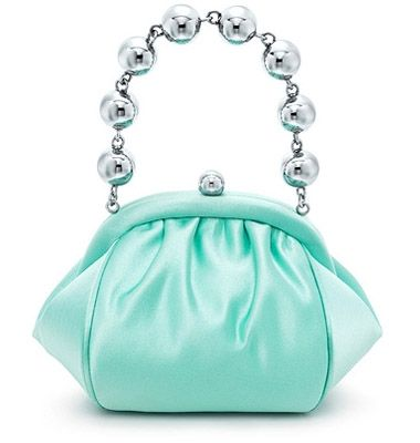 ntroducing Tiffany's new leather goods collection. Part of the collection is this blue bracelet bag in Tiffany signature blue in satin with ...