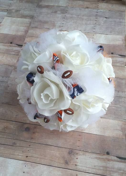 Handmade silk rose Denver Broncos football themed wedding bouquet made by Sunshine Petals Boutique.  Artificial Flowers * Events Essentials * Home Decor & More!  Rhonda Newton, Owner - 208.262.6148.