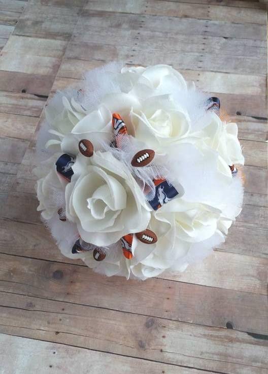 Handmade silk rose Denver Broncos football themed wedding bouquet made by Sunshine Petals Boutique.  Artificial Flowers * Events Essentials * Home Decor & More!  Rhonda Newton, Owner - 208.262.6148.