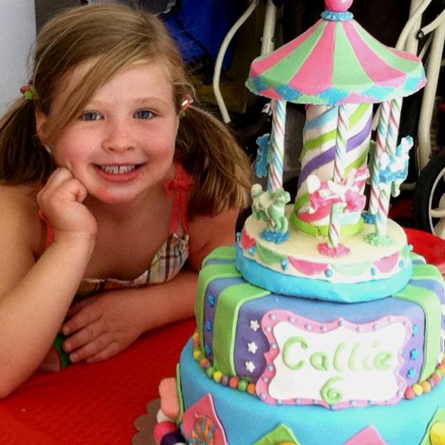 Carnival themed birthday cake. Carousel is chocolate.