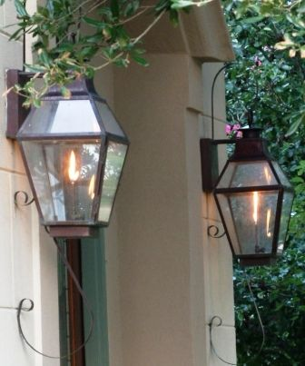 Gas Lanterns... SOOO pretty instead of traditional front porch lights! I love the way they flicker at night :)