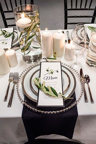 Touch of Black Wedding Inspiration - Black chiavari chairs and napkins with glass beaded charger plate, menu, and greenery and candles centerpiece. #touchofblack #weddingdecor