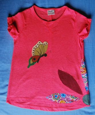 Girls t-shirt with fabric and paint applique. Materials: Cotton fabric and fabric paint