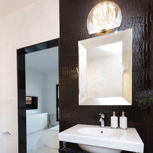 Two Mirrors In The Bathroom: A Large Black Framed Floor Mirror And A Silver  Framed Wall Mirror