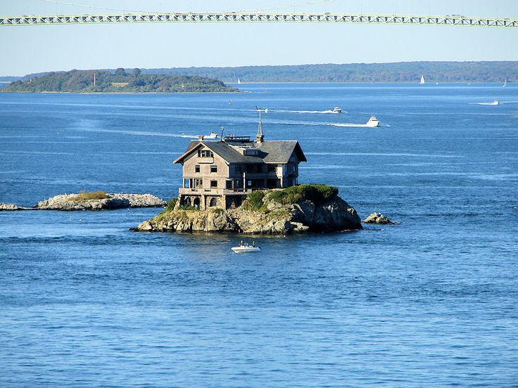 View Of Cling Rock & Cling Rock House With The Claiborne Pell Bridge, Commonly Known As The Newport Bridge. Rose Island & Rose Island Lighthouse In Foreground. Newport Harbor, Newport, Rhode Island, United States. Travel, Tours Photos, Pictures, Information, & Reviews.