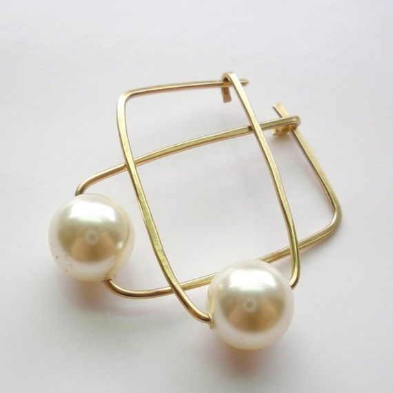 The small elongated hoops are adorned with 8mm Ivory Swarovski Crystal pearls. They are made from 19 gauge 14K gold fill wire that has been forged, hammered, and polished. $29