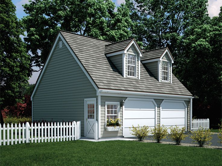 Appealing two-car garage has twin dormers on roof for added charm