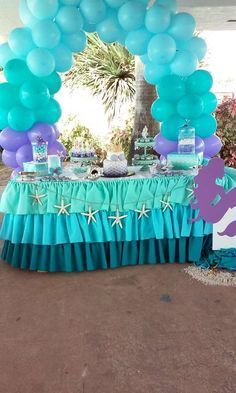 Balloon arch and dessert table at a mermaid birthday party! See more party planning ideas at CatchMyParty.com!