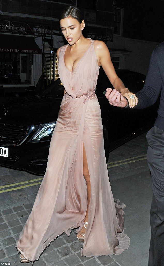 Not flying under the radar: Meanwhile Irina made sure she was noticed in her plunging dres...