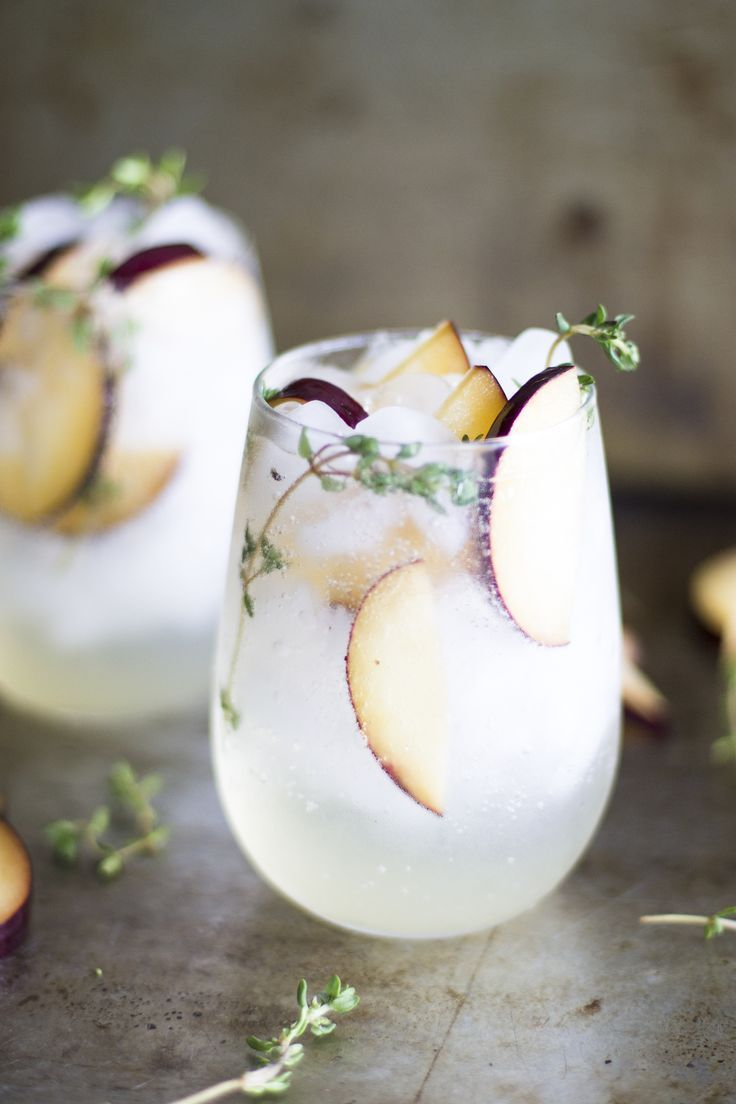 Plum and Thyme Prosecco Smash. Gorgeous cocktail for a late summer cocktail party.