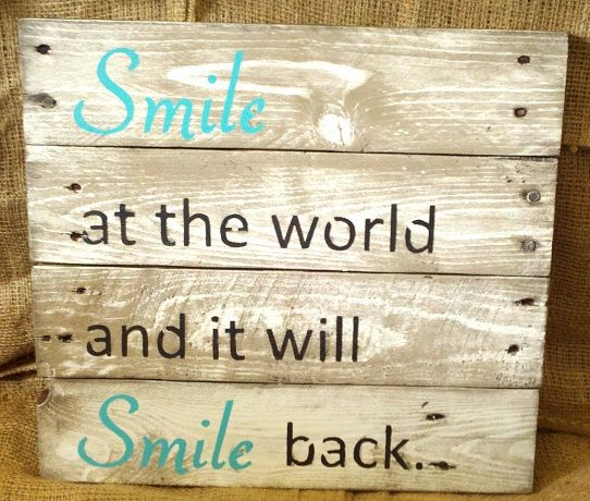 "Pallet sign, ""Smile at the world..."""