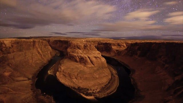 The Horseshoe Bend in the Glen Canyon of the northern Arizona is a stunning site in day. But at night it's a challenge, not a place to make any mistake! The canyon drops 300 meters down to the Colorado River at the overlooking point and in order to see the entire river bend you need to be right at the edge. For inquiries please contact me (btafreshi@twanight.org, www.twanight.org/tafreshi). The footage is available to license in fullHD, 2k, and 4k. Still photography of this scene:  1…