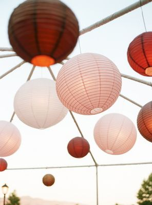 Paper lanterns in shades of pink hang above the outdoor dance floor.  Photo by Shelly Kroeger