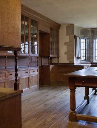 The Butler's Pantry at Castle Drogo, Devon, with the oak table and cupbaords designed by the architect of the house, Edwin Lutyens