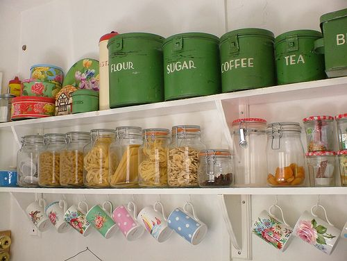 Sweet!  Cath Kidston mugs, pasta in jars, and vintage kitchen tins in the best green possible